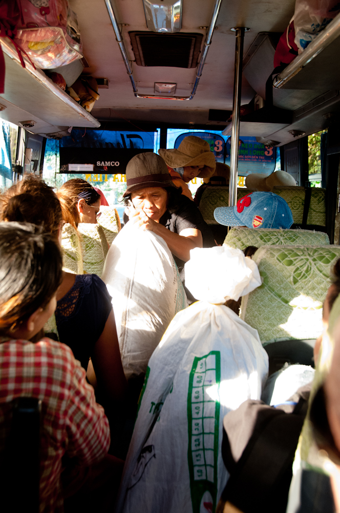 The bus ride was very enjoyable. No A/C but the wind was nice and cool.. This lady was boss of the bus. She made use of every floor space to store people's belongings, was amazingly efficient at getting the bus going but that meant ordering us around.