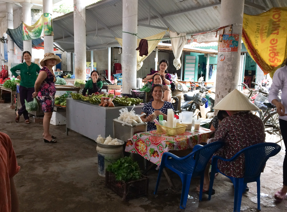 We bought food from this market tucked between shops.  They were great fun.  They even helped Alvin as one lady selling him meat was trying to cheat him so all these ladies came to his defence!