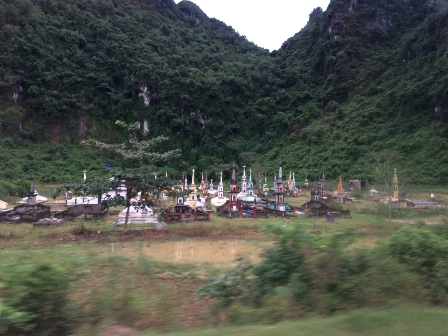A common sight in Vietnam.  Cemeteries in the fields where families grew crop.