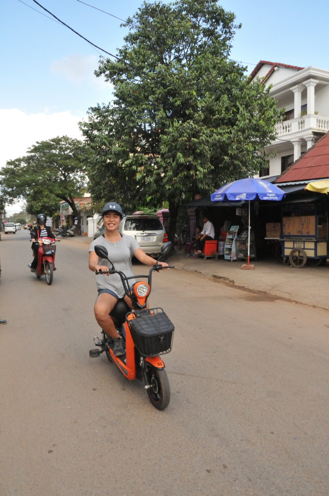 Emma loving the electric bike. It's only for the city as the batteries won't last long enough to tour around the temples so we tried it just for fun.