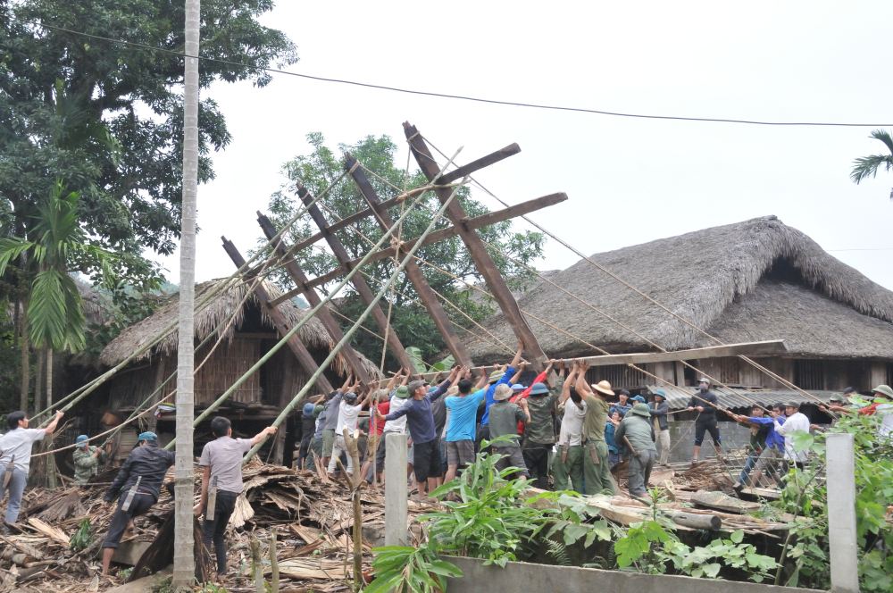 People from community undoing the main communal building.