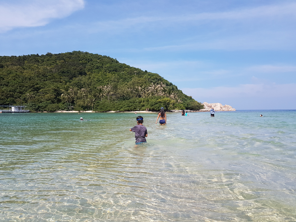 An island found near the north of the Koh Phangan.  We could reach it by walking on a path of sand/coral.  Great for snorkeling.  Only Eli had a snorkeling set (which worked poorly), the rest of us just wore goggles.  We saw fish and living corals!
