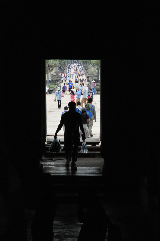 Exiting the Angkor Wat and the people begin to enter the temple