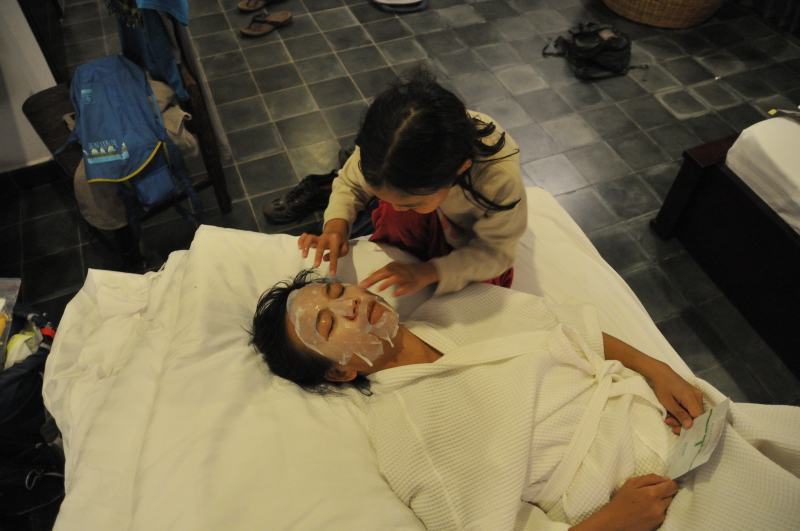 Lucy giving mother a facial.