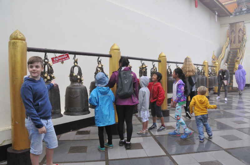 The signs says no touching but these asian tourists enjoy to bang the bells with their knuckles quite forcefully.