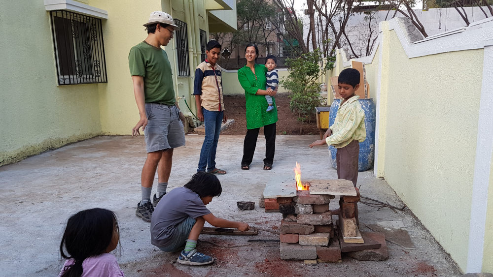 Alvin, Eli and a few helpers built a rocket stove!