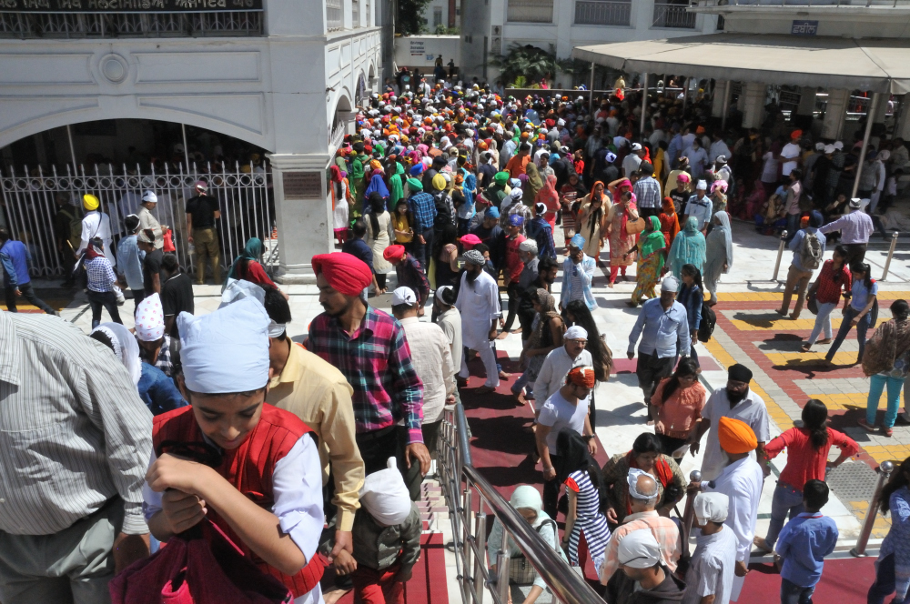A visit to Gurudwara Bangla Sahib, Sikh Temple where they generously fed all who visits.  There were thousands lining up for a meal.  We needed to cover our heads and remove our shoes.  Lucy was feeling ill so we did not stay long.
