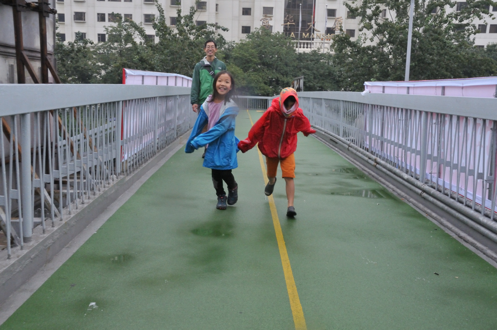 Crossing the streets on the overpass - Beijing, China