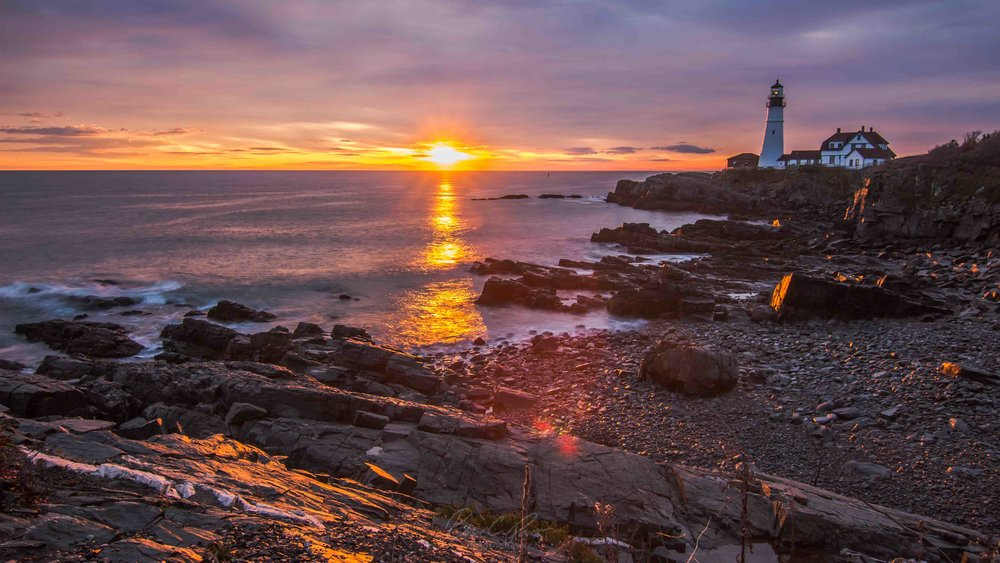 Sun Peaking Above the Horizon at Portland Headlight