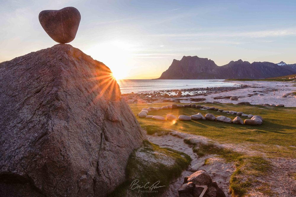 Heart shaped rock on beach in Lofoten Islands Norway