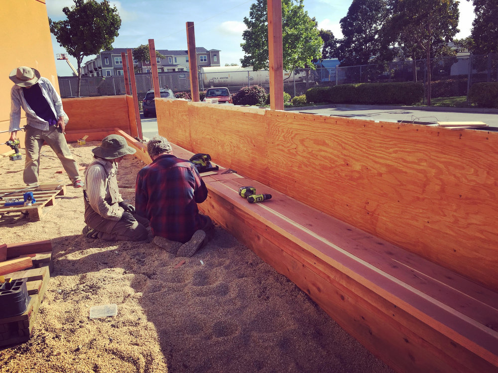 Our expert carpenters hard at work making woody magic happen in the beer garden.