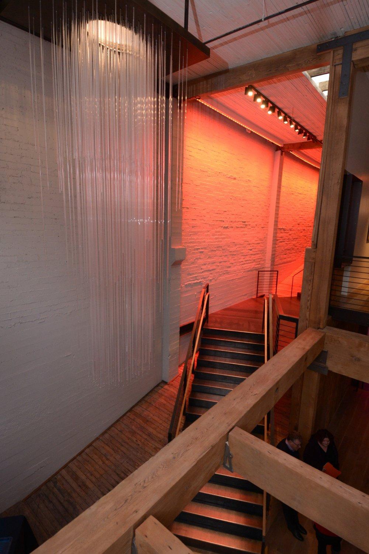 block41-cascading-chandalier-dramatic-stairwell.jpg