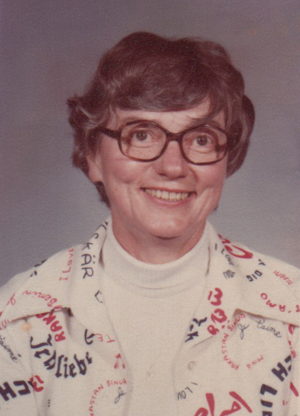 "Jean Mehlenbacher. On the back it says, ""My school picture!"" Her shirt says, ""I love you"" in many languages."