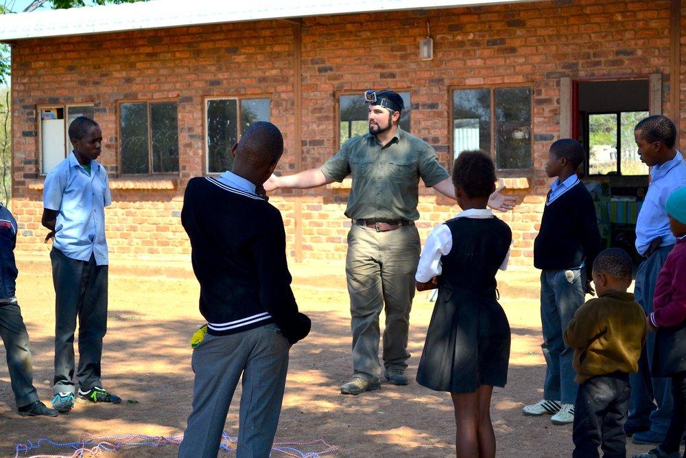 Mike Talking w:School Kids.JPG