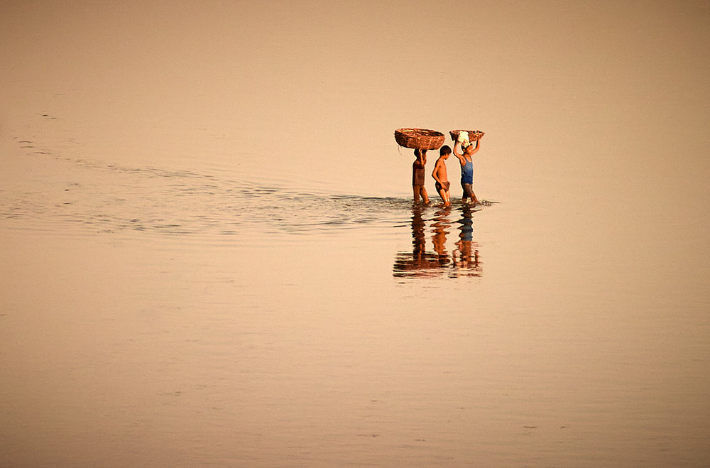 Youths in the Yamuna River, Agra, India