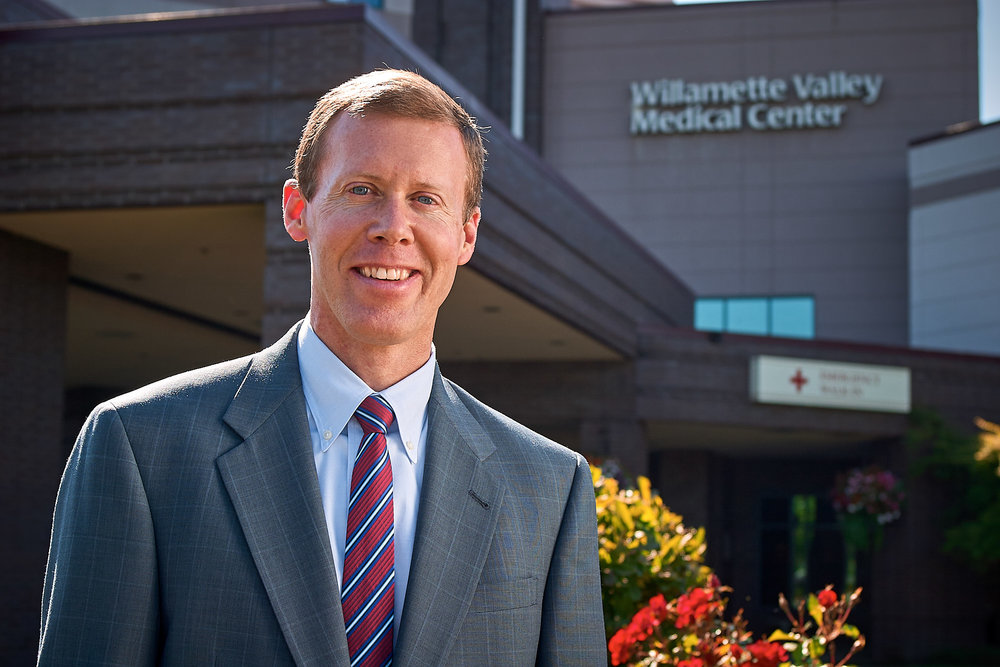 CFO in Front of Hospital Entrance, Willamette Valley Medical Center, McMinnville, Oregon