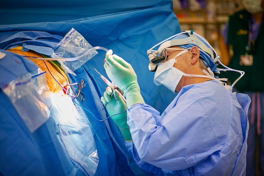 Surgeon Performing Spinal Surgery, Portland, Oregon