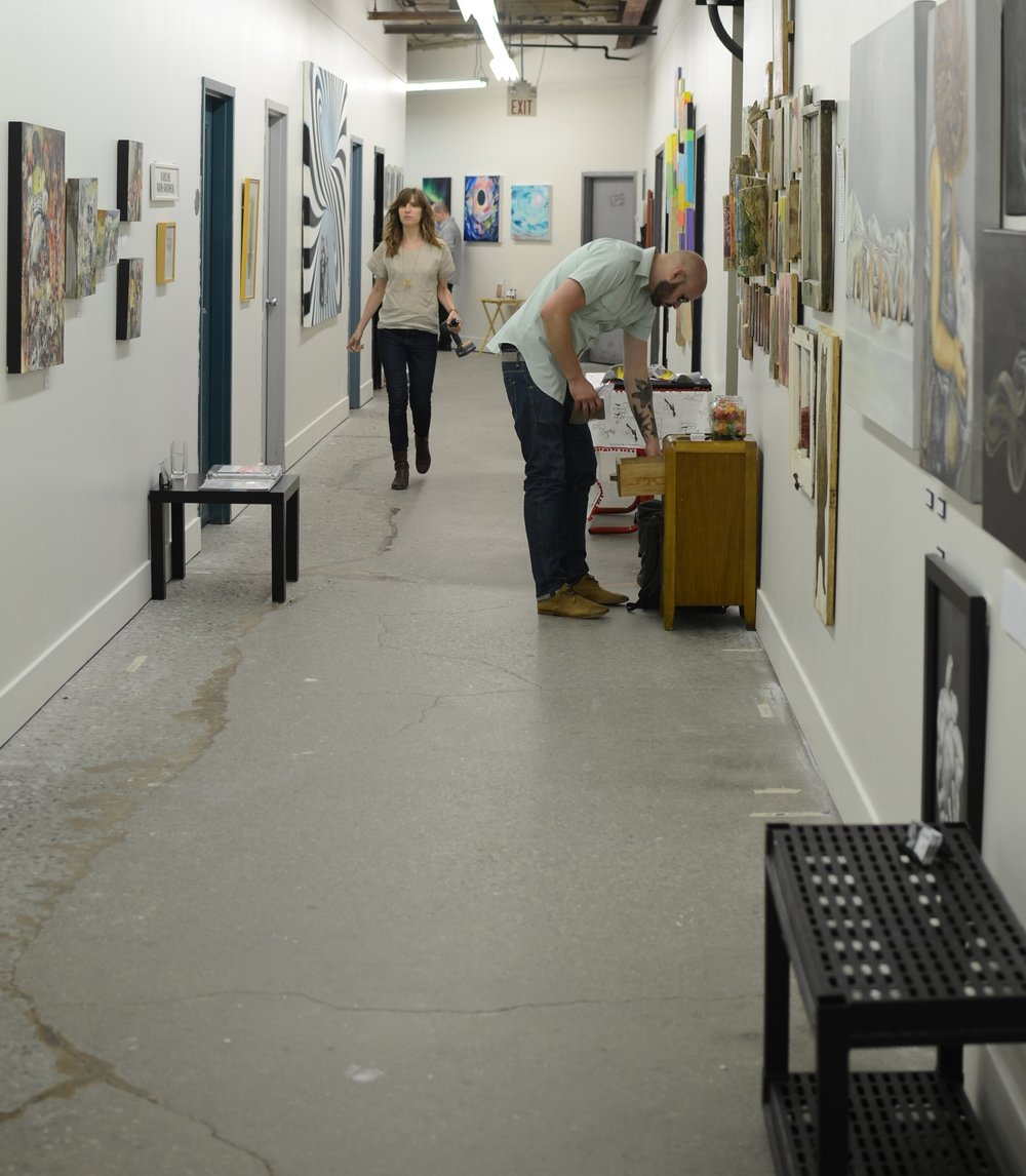 Photo by Lauren Judge, Setting up for the semi-annual Globe Studios Art Show & Sale