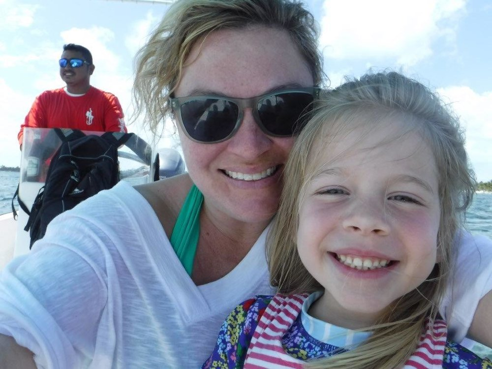 My girl and me chilling on the boat during our fishing and snorkling excursion.
