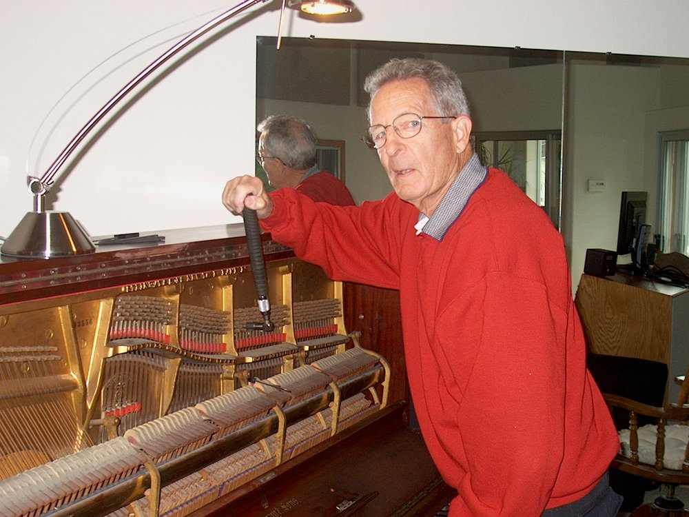 Piano Tuner Chuck H mans the controls