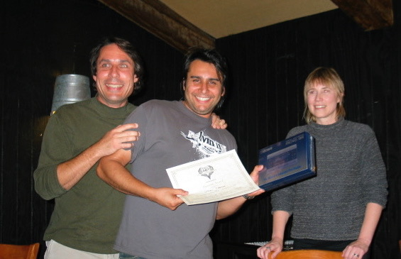 Steven Ybarra wins SDSG Song Contest, as Mark & Bridgett Brigitte look on