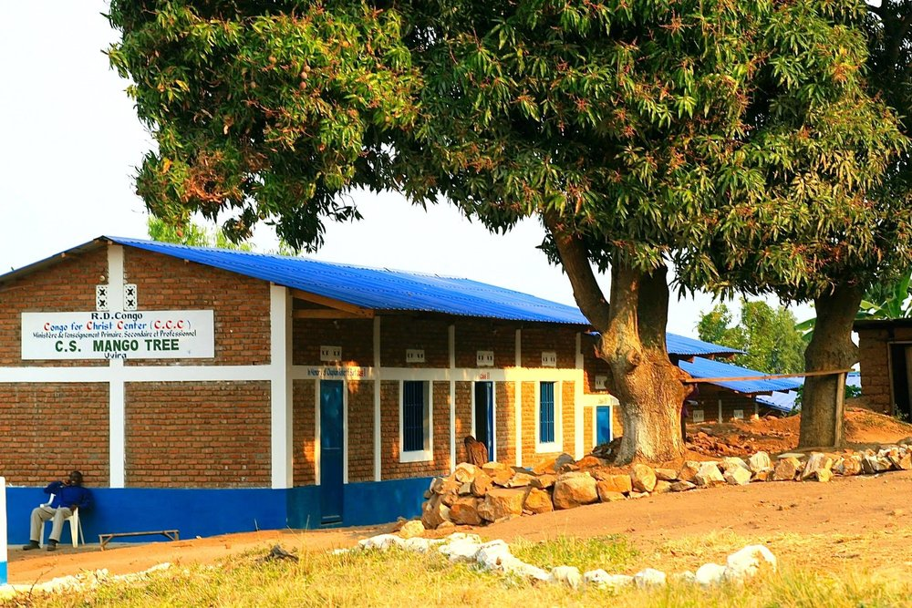 Mango Tree School stands underneath the Mango Tree