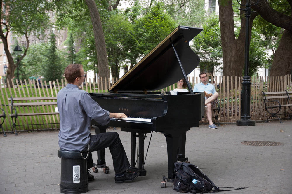 A classical pianist plays in Washington Square Park, New York.