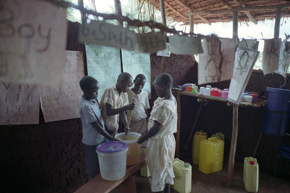 Students purifying water in uganda
