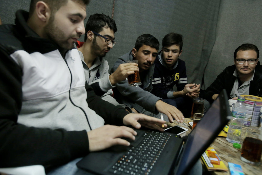 nethope, which has helped refugees access technology, is okta's first grantee. photo:  Panayotis Tzamaros/shutterstock