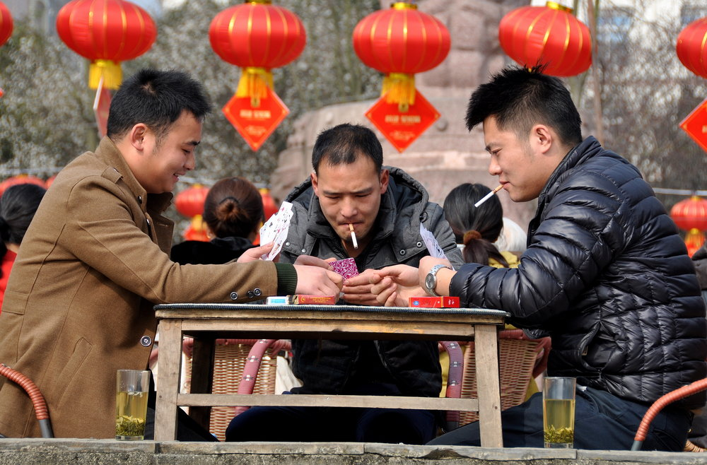 Men smoking in China. credit:  LEE SNIDER PHOTO IMAGES/shutterstock