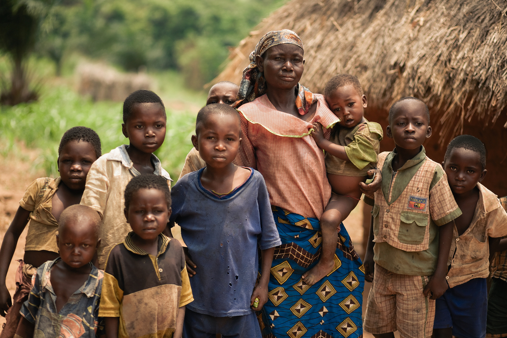 a mother with her children in congo. photo:  Valeriya Anufriyeva/shutterstock