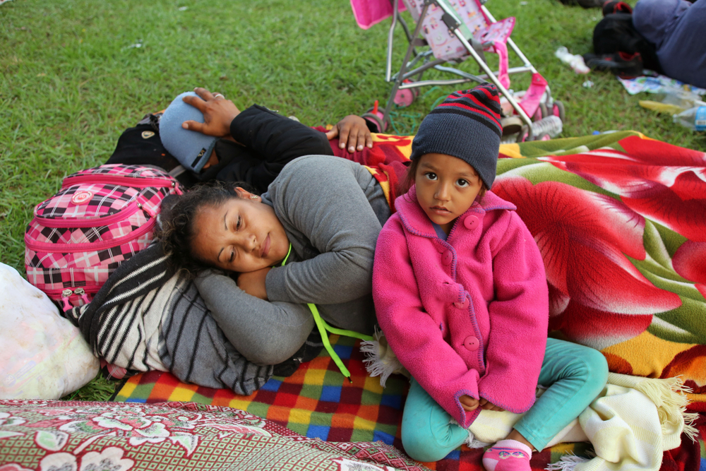 A Salvadoran family fleeing poverty and gang violence in Oaxaca, Mexico last year. Vic Hinterlang/shutterstock