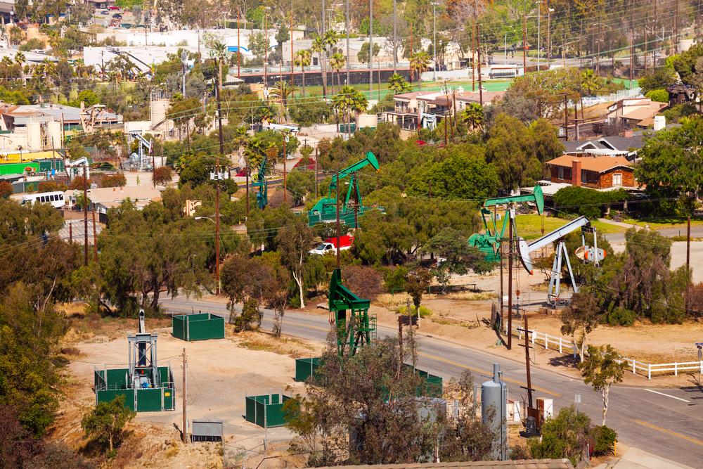 Oil rigs still operate near some of LA's poorest neighborhoods. Sergey Novikov/shutterstock