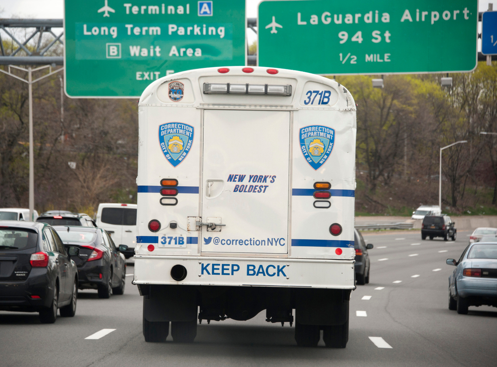 A corrections bus transports prisoners to Rikers island. SkunkChunk/shutterstock