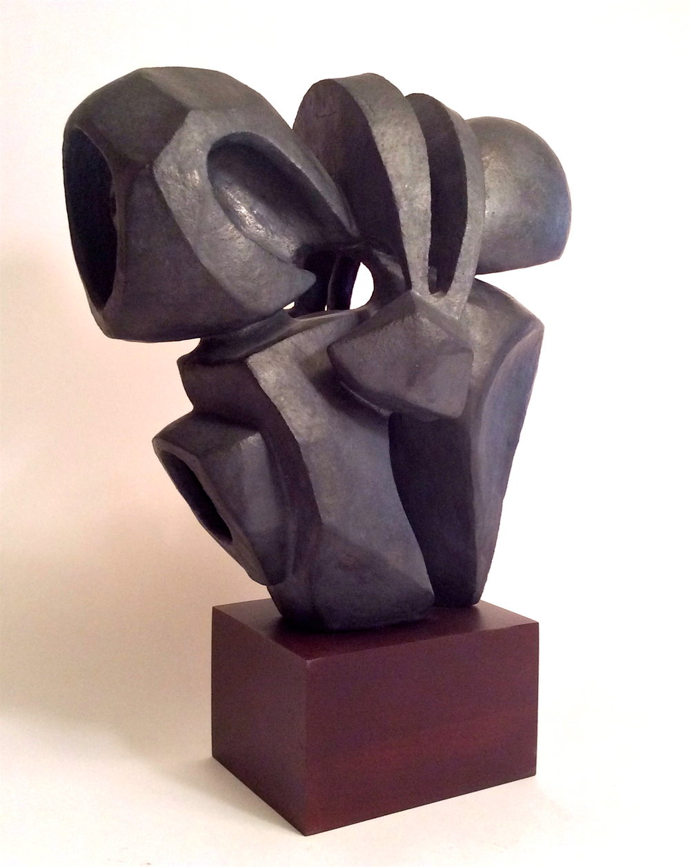 """Sculpture clay with iron oxide glaze on cherry base. 2010. 14"""" H."""