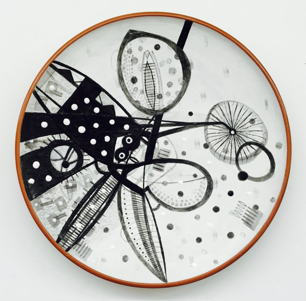 "Skura/ Knight 2010. Earthenware/ majolica. 18"" in diameter x 3"" H."