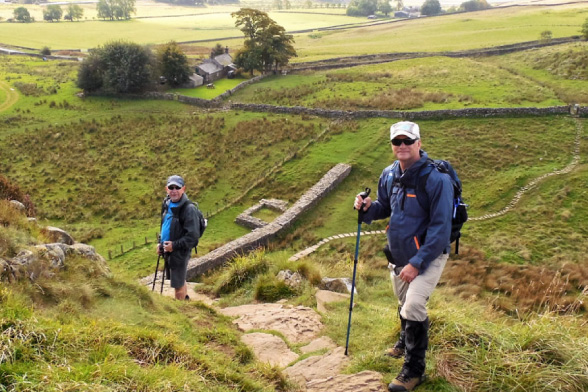 Hikers descending to Hadrian's Wall