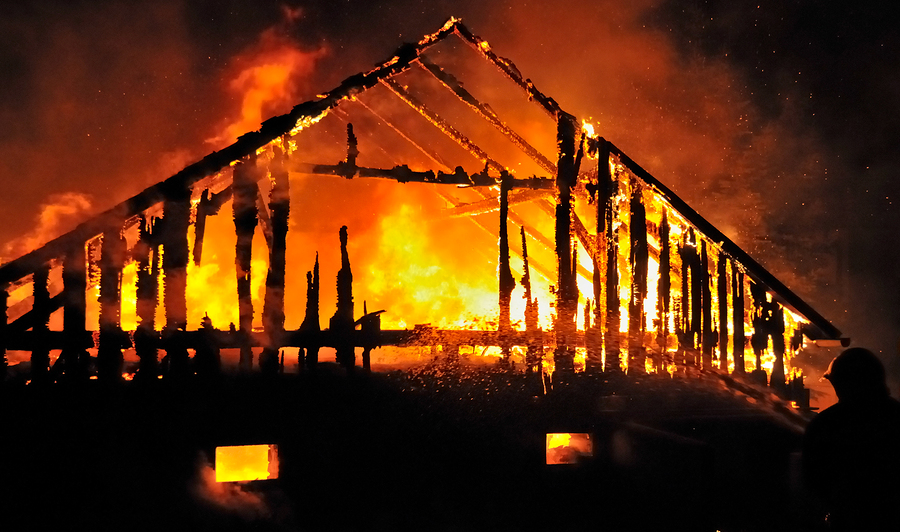 Timber house burning.jpg