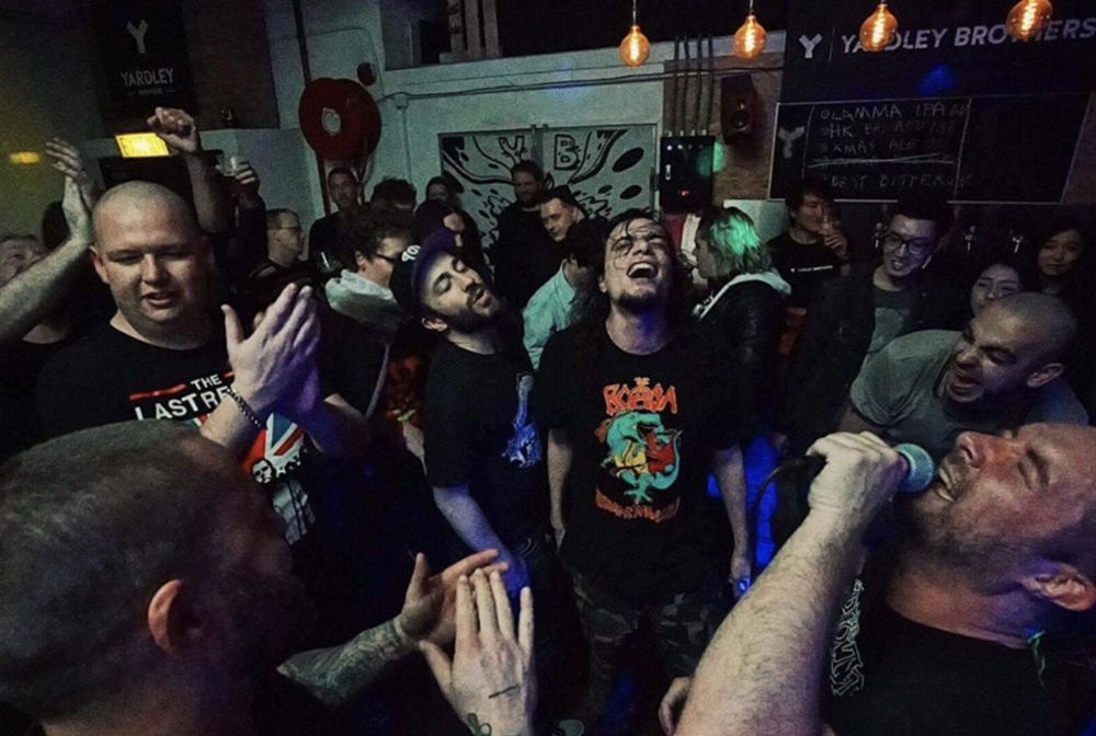 "Defiant Scum leading a singalong of ""Fuck you, I'm drunk,"" with backing vocals from members from Say Mosquito and Two Finger Salute"
