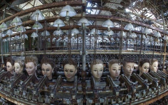 Beautifully unnerving photo of an abandoned doll factory by  Bousure