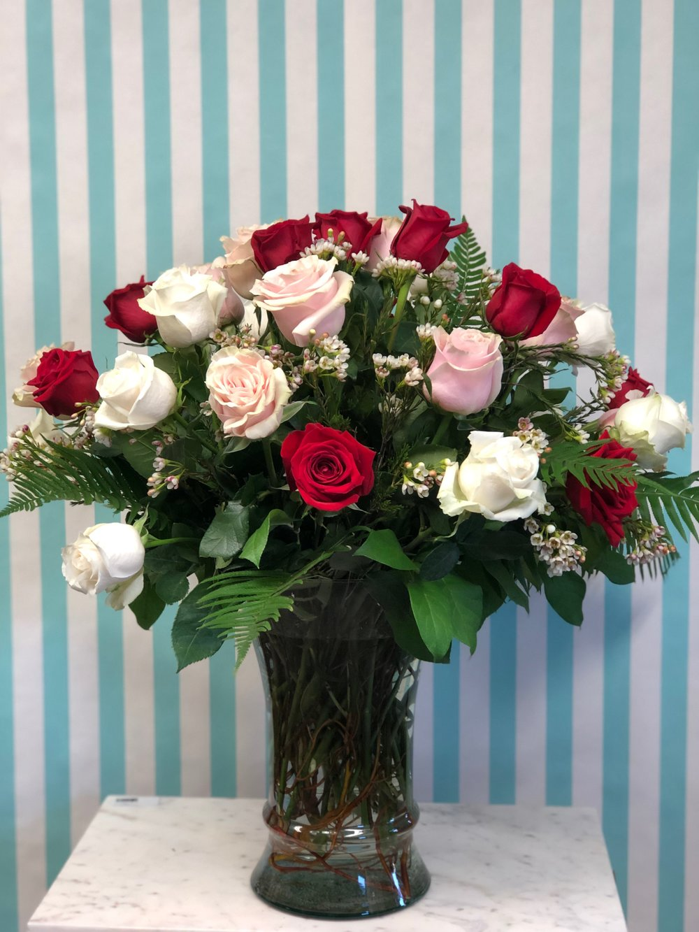 Mac Daddy-$300   Show her how much you love her with this spectacular display. 3 dozen long stem roses arranged in a vase with all the bells and whistles. Colors may vary unless specified.