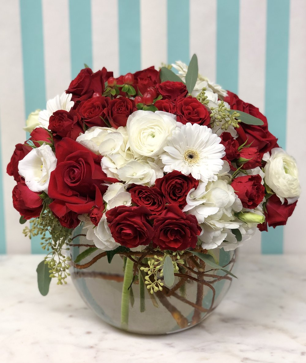 Sweetheart Bowl- $150   Standard, and Sweetheart Roses arranged amongst hydrangea, ranunculus, lisianthus, and Gerber daisies.