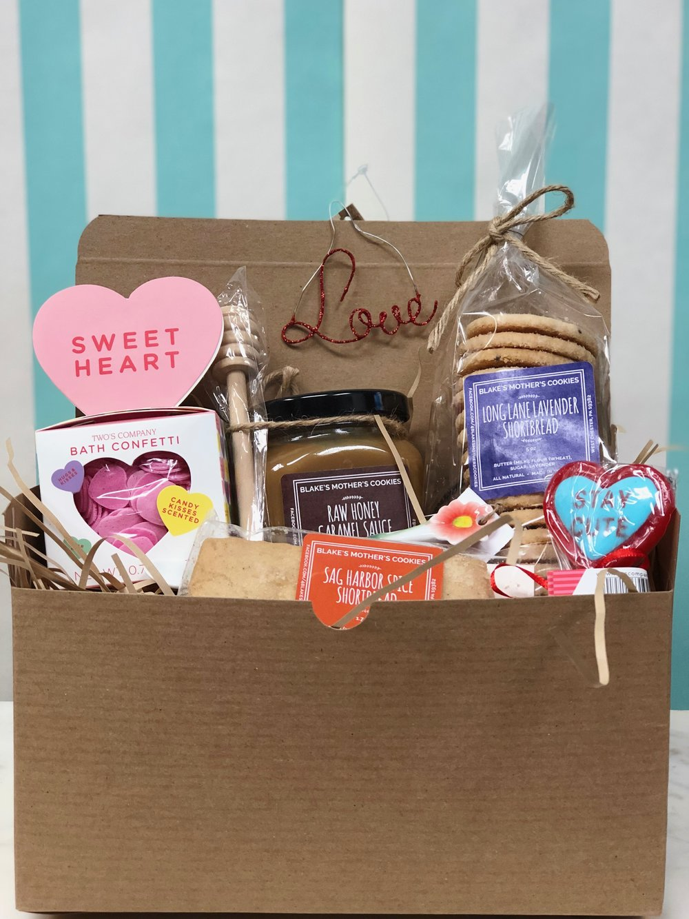 Large Box of Love- $59.99   Our large box is perfect for your sweetheart with a sweet tooth. Filled with homemade confections from Blake's Mother's Cookies and bath confetti.
