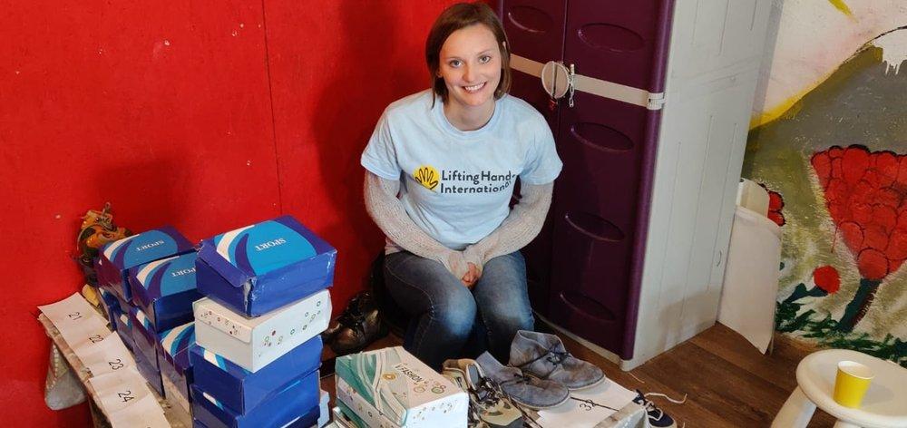 Hannah at shoe distribution!