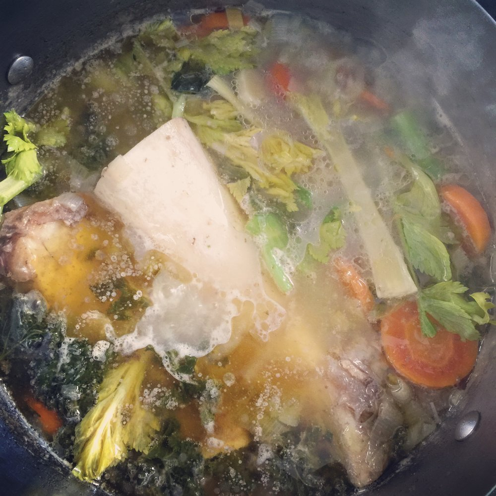 Soup being prepared using slow-cooked bone broth from Bone Brewhouse.
