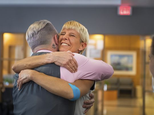 Tyler Gallagher hugs Beth Newton, a physical therapist at Robert C. Peace Rehabilitation Hospital, as he thanks all of the first responders who saved his life after being hit by a truck in June at Greenville Memorial Hospital on Tuesday, November 22, 2016.  (Photo: LAUREN PETRACCA/GreenvilleOnline)