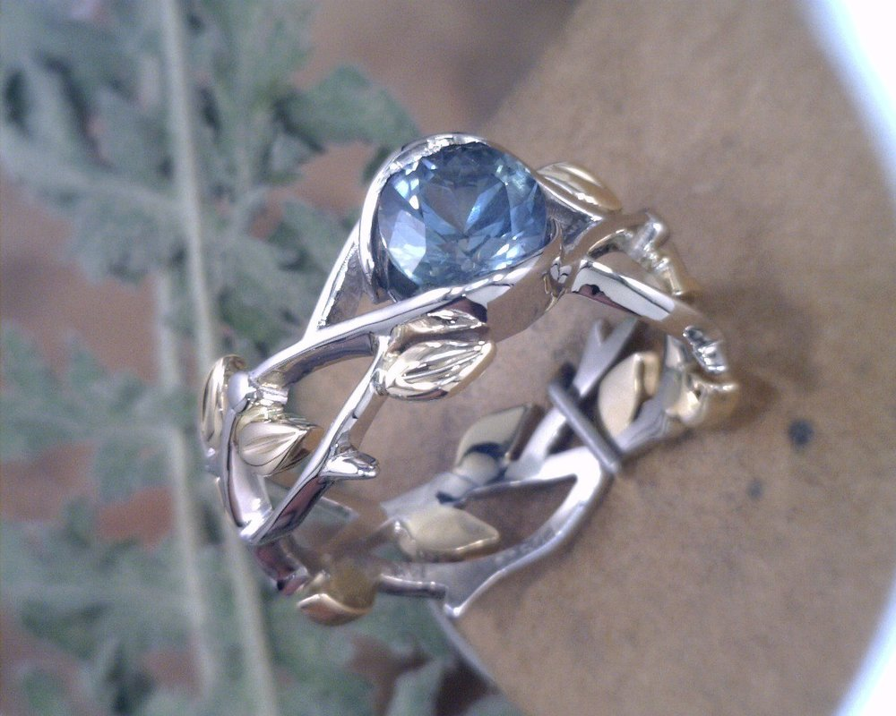 Montana Sapphire stone with palladium and yellow gold band.jpg