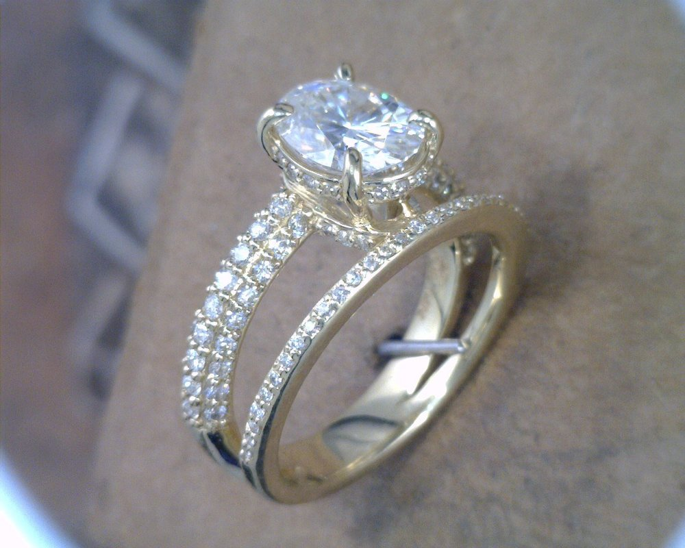 oval diamond engagement ring with halo and connected anniversay band.jpg