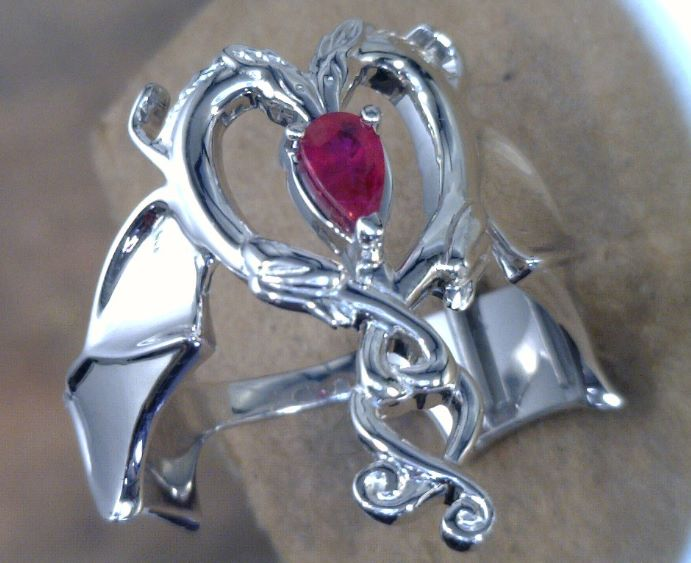 pear-shaped ruby in heart setting palladium ring.jpg