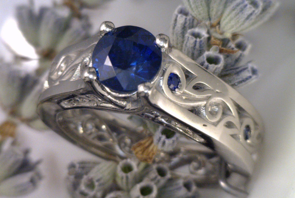 3_4 ct. round Sapphire set in floral inspired setting.png